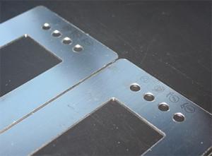 01E marcatge làser alumini caratules